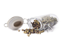 Glass jar filled with peppercorn isolated Royalty Free Stock Image