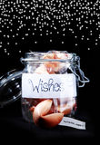Glass jar of fortune cookies as a gift Royalty Free Stock Image