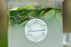 Glass jar of fresh green lemonade on wedding candy bar. Summer p. Arty and reception in forest Royalty Free Stock Images