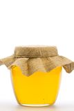 Glass jar of fresh honey  isolated on white background Royalty Free Stock Photo