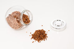 Glass jar full of buckwheat seeds Royalty Free Stock Photography