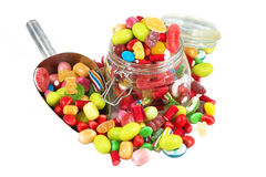 Glass jar full of candies. Isolated in white background Royalty Free Stock Image