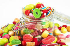 Glass jar full of candies Royalty Free Stock Photo