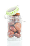 Glass jar full with chestnuts Stock Images