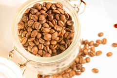 Glass jar full of coffee beans Royalty Free Stock Photos