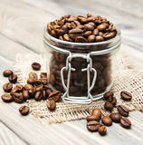 Glass jar full of coffee beans Royalty Free Stock Image