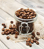 Glass jar full of coffee beans Stock Photos