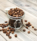 Glass jar full of coffee beans Stock Image