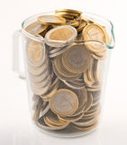 Glass jar full of coins Royalty Free Stock Photography