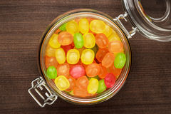 Glass jar full of colorful sweets Stock Images