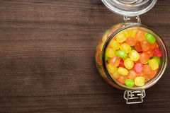 Glass jar full of colorful sweets Royalty Free Stock Images