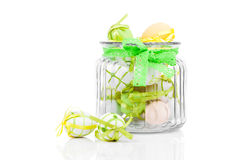 Glass jar full with Easter eggs Stock Image