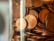 A glass jar full of euro cent coins. Closeup of a glass jar full of euro cent coins royalty free stock images