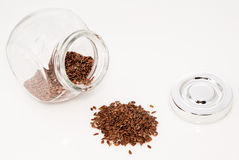 Glass jar full of flaxseed Royalty Free Stock Photography