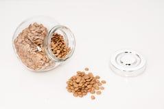 Glass jar full of green lentil stock image