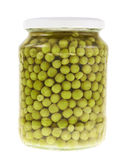 Glass jar full of green peas Stock Photos