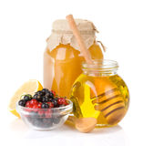 Glass jar full of honey and berry Stock Photography