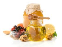 Glass jar full of honey, lemon and berry Royalty Free Stock Images