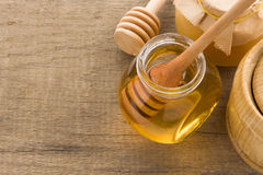 Glass jar full of honey and stick Royalty Free Stock Image