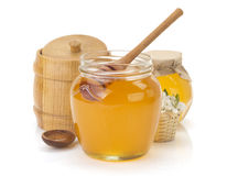 Glass jar full of honey and stick Royalty Free Stock Photos