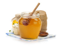 Glass jar full of honey and stick Stock Photo