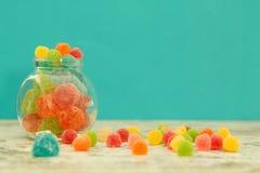 Glass jar full of jelly beans Stock Photo