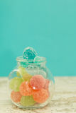 Glass jar full of jelly beans Stock Photos