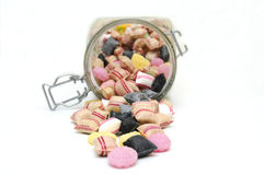 Glass jar full of mixed candies. Royalty Free Stock Photos
