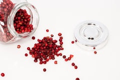 Glass jar full of red pepper seeds. Ready to use Stock Photography