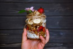 Glass jar with granola in hand stock photos