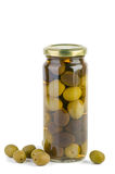 Glass jar with green and black olives . Some near. Glass jar with green and black olives. Some near. Isolated on the white background stock photography