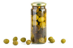 Glass jar with green and black olives . Some near. Glass jar with green and black olives. Some near. Isolated on the white background stock image
