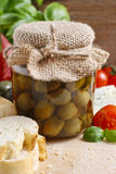 Glass jar of green olives Royalty Free Stock Image