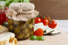 Glass jar of green olives Stock Photo