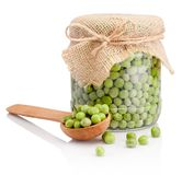 Glass jar of green peas isolated on white background. Glass jar of green peas isolated on a white background royalty free stock photos