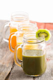 Glass jar of healthy kiwifruit smoothie Royalty Free Stock Photo