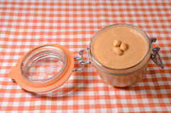 Home made peanut butter. Glass jar of home made peanut butter Stock Images