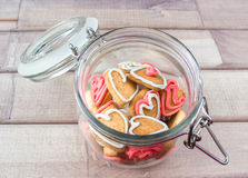 A glass Jar with homemade heart shaped cookies Stock Photos