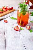 Glass jar with homemade strawberry compote Royalty Free Stock Photos