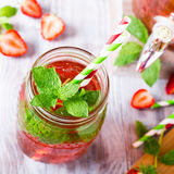 Glass jar with homemade strawberry compote Stock Photo
