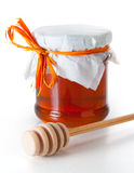 Glass jar of honey Stock Photos