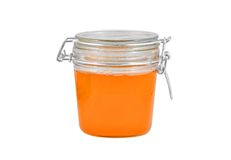 Glass jar with honey Royalty Free Stock Images