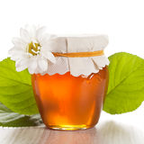 Glass jar with honey isolated Royalty Free Stock Photos