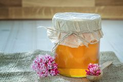 A glass jar of honey Royalty Free Stock Photo