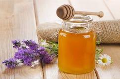 Glass jar of honey Stock Photos