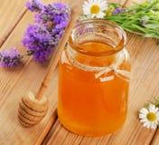 Glass jar of honey Stock Photography
