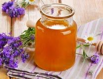 Glass jar of honey Stock Images