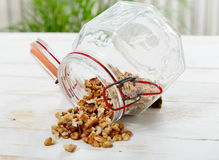 Glass jar with hulled nuts. A glass jar with hulled nuts Royalty Free Stock Photo