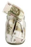 Glass jar with a hundred-ruble bills. Hundred rubles in a glass jar royalty free stock photography