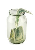 Glass jar of hundreds of dollars Stock Images